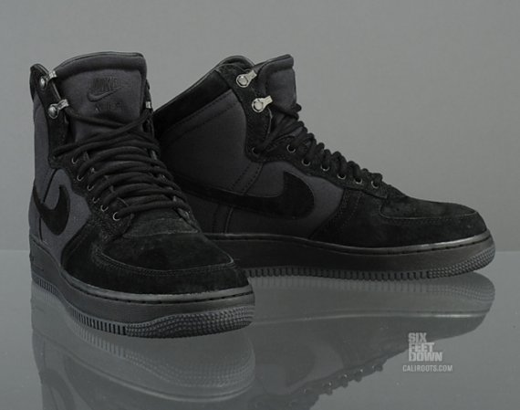 sports shoes 31602 08472 Nike continues its Air Force 1 Military Boot lineup with this new blacked  out pair. From top to bottom, entire sneaker has been blacked out, ...