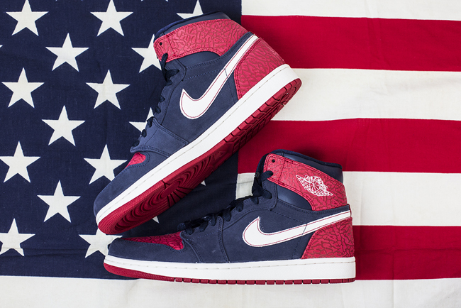 ... Air Jordan 1 High. Featuring a navy suede upper with red elephant print  and a white swoosh, this is the perfect pair to show your love for the USA,  ...