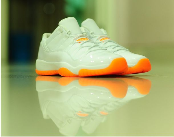 4fce716beaf The White/White-Citrus Air Jordan 11 Low GS is slated for a June 20, 2015  release. Releasing only in kids sizes, pricing is set at $120.