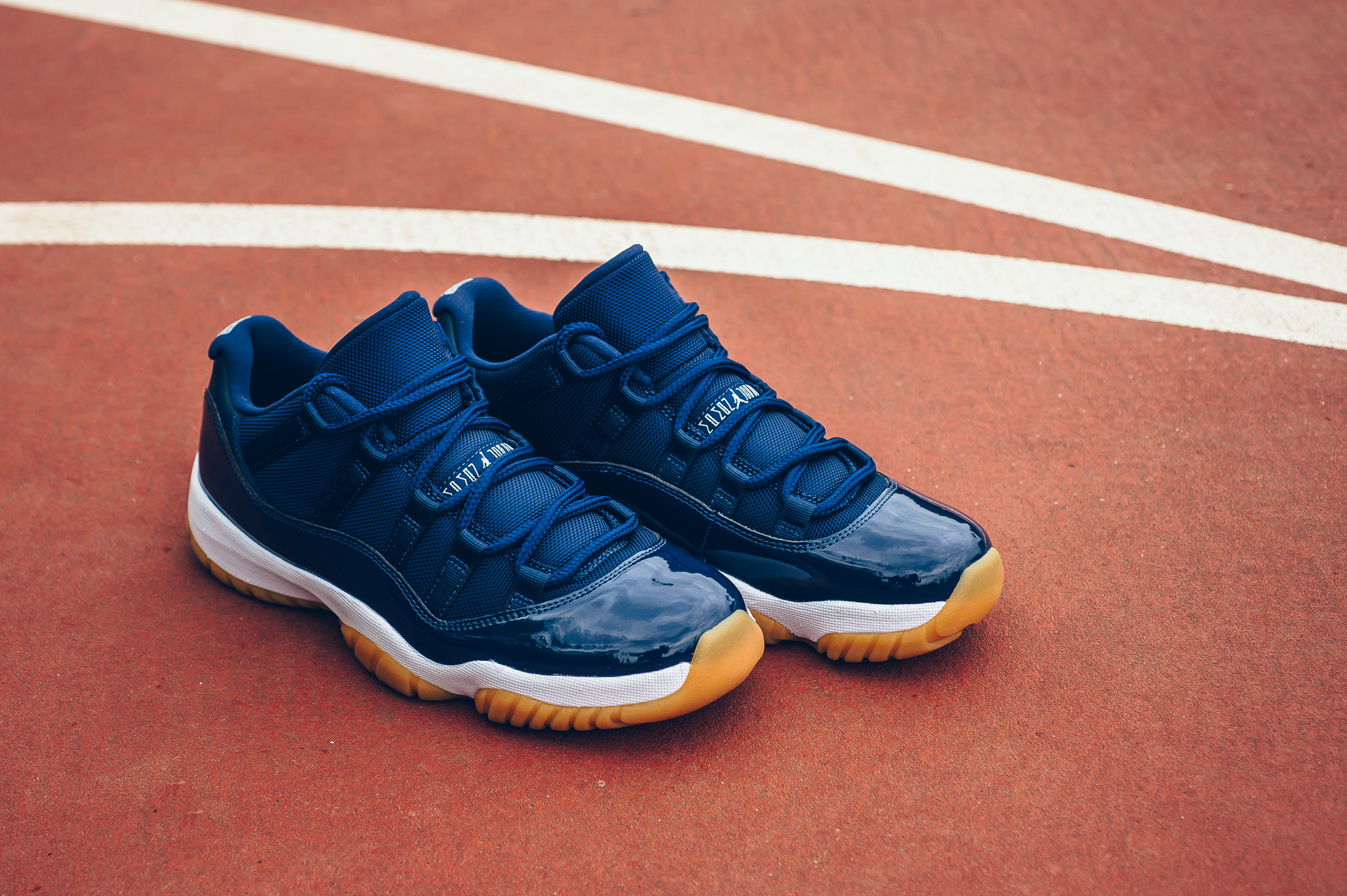 air jordan xi retro low midnight navy. Air Jordan 11 (XI) Retro Low Color  Midnight  Navy White-Gum Light Brown 6158e0717
