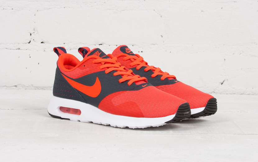 hot sale online 2beb9 997b1 The Nike Air Max Tavas continues to impress with hot new colorways like  this Rio Dark Obsidian release. In comes wrapped in an even balance of  bright orange ...