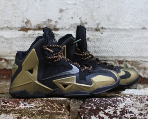 newest be13e 6ab30 A set of black and gold laces keep things color-coordinated, white a black  outsole does the rest. What do you think of this colorway  Nike Lebron 11  ...